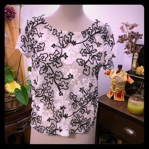 Antropología blouse beige ribbon and black rope